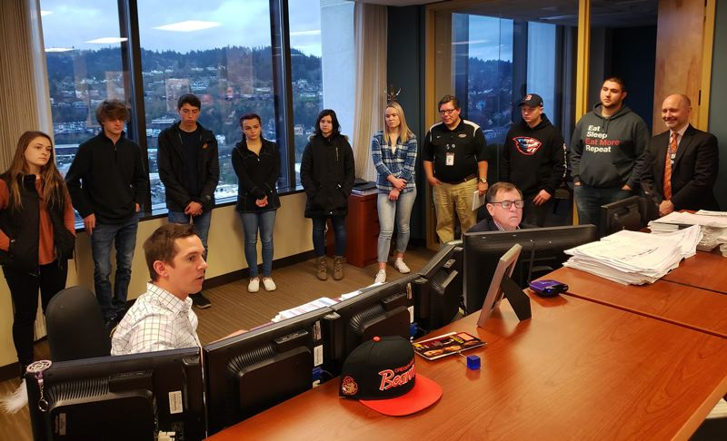 SUBMITTED PHOTO - Marketing students from Oregon City High School had the rare opportunity to witness the sale of their district's school bonds while learning about finance careers.