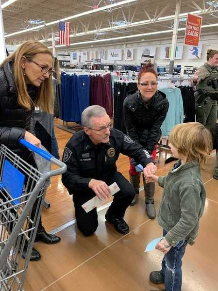COURTESY PHOTO: MOLALLA POLICE - Molalla Police Chief Rod Lucich shops with a local child during the annual Shop with a Cop event on Dec. 8.