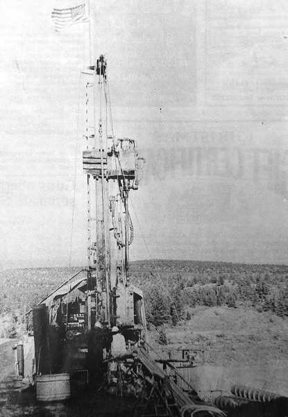 """CENTRAL OREGONIAN FILE PHOTO  - Dec. 16, 1993: Bureau of Reclamation workers are drilling into the core of the Ochoco Dam to obtain samples that will reveal soil """"properties."""" Ochoco Reservoir will be drained """"dry"""" in the coming months so that construction on the dam can begin in June."""