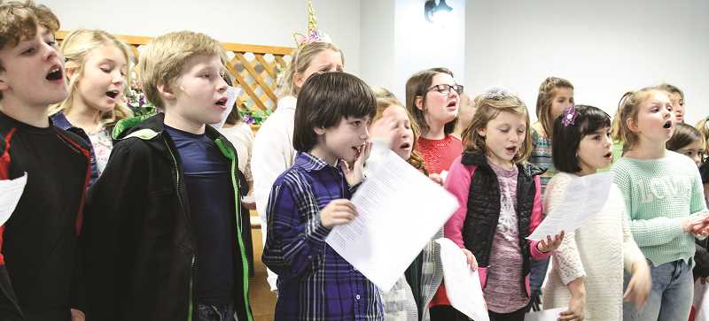 JASON CHANEY/CENTRAL OREGONIAN  - The Barnes Butte Elementary Honor Choir visited Regency Village, Prineville Senior Center and Carriage House on Thursday, where they sang an assortment of Christmas carols.
