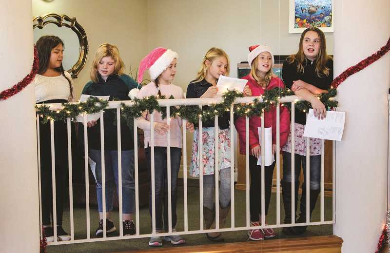 JASON CHANEY/CENTRAL OREGONIAN  - The third, fourth and fifth grade students in the Barnes Butte Elementary Honor Choir sang Christmas Carols to the residents at Regency Village in Prineville last Thursday.
