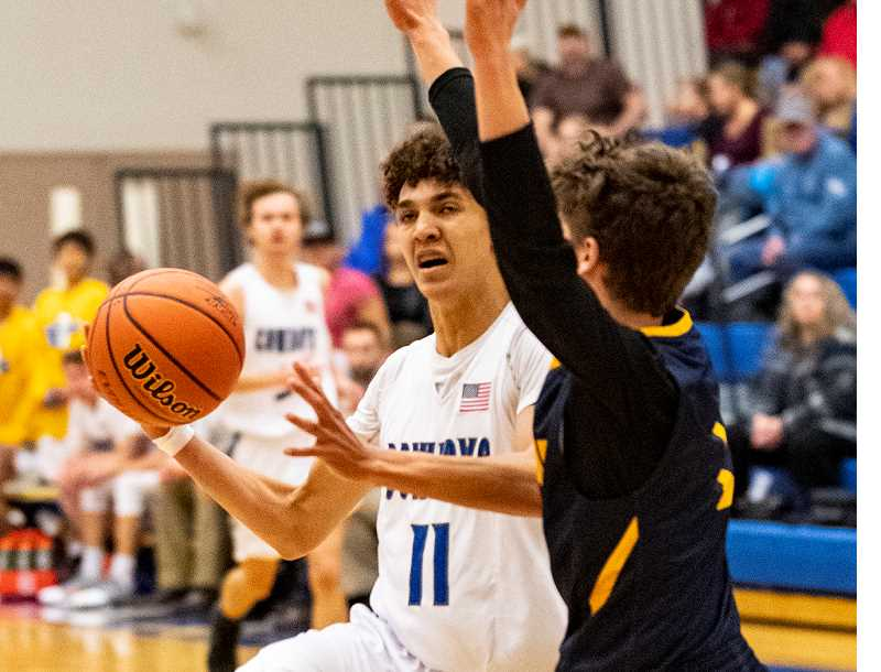 LON AUSTIN/CENTRAL OREGONIAN - Thaiden Mullan drives to the basket during a game earlier this year. Mullan led the Cowboys in scoring at the three-day Les Schwab Holiday Classic Basketball Tournament, which was held in Coos Bay over the weekend. Mullan scored 13 points against La Salle Prep, 21 against Junction City, and 10 against Sutherlin as the Cowboys went 1-2 at the tournament.
