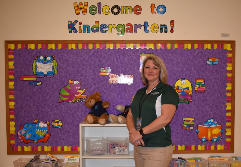 OUTLOOK PHOTO: TERESA CARSON - Kate McLaughlin, director of elementary education and federal programs at Reynolds School District, moved frequently as a child and was inspired by the kindness and dedication of teachers.