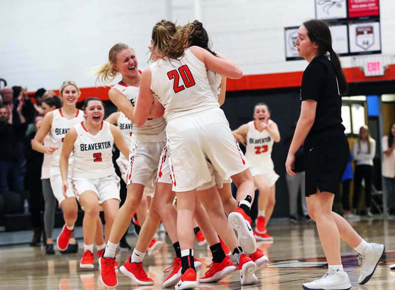 TIMES PHOTO: DAN BROOD - Members of the Beaverton girls basketball team, including Mackenzie Naro (2), Mary Kay Naro and Laura Erickstrup start to celebrate following the Beavers' 41-40 win over Tigard on Friday.