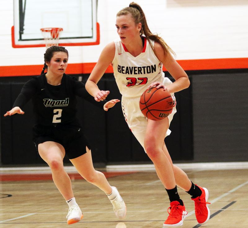 TIMES PHOTO: DAN BROOD - Beaverton junior Sydney Erikstrup (right) brings the ball up court against Tigard junior Kennedy Brown.