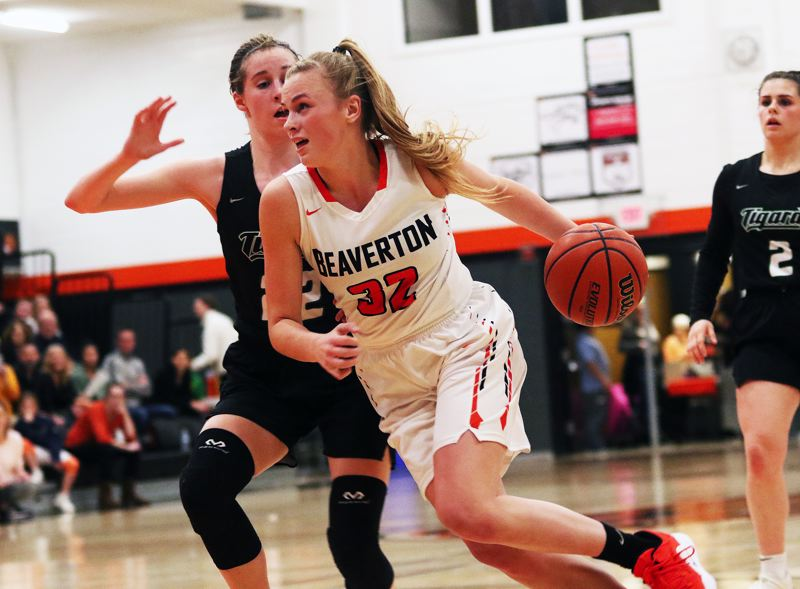 TIMES PHOTO: DAN BROOD - Beaverton junior Sydney Erikstrup (32) drives against Tigard junior Delaney Leavitt during Friday's game.