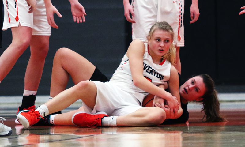 TIMES PHOTO: DAN BROOD - Beaverton junior Mary Kay Naro and Tigard senior Campbell Gray battle for a loose ball during Friday's game.