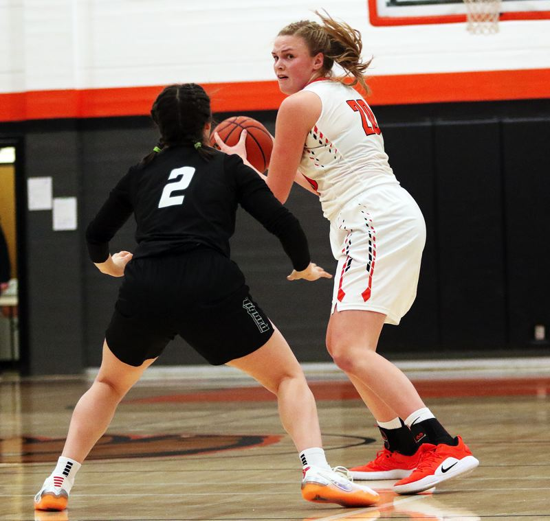 TIMES PHOTO: DAN BROOD - Beaverton junior Laura Erikstrup (right) looks to pass the ball inside against the pressure of Tigard junior Kennedy Brown.