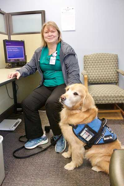 OUTLOOK PHOTO: CHRISTOPHER KEIZUR - Vicky Ascoli, a certified medical assistant at the clinic, is more famous as Akinas mom.