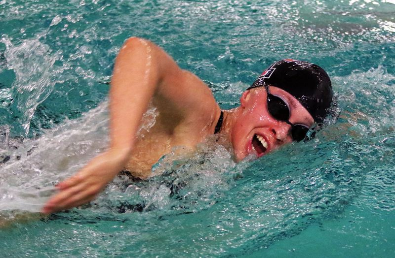TIMES PHOTO: DAN BROOD - Tualatin junior Britney Muralt is on her way to a victory in the 500-yard freestyle event during the Wolves' meet with Lakeridge.