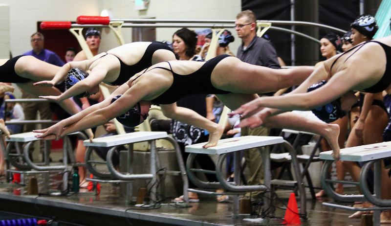TIMES PHOTO: DAN BROOD - Tualatin junior Abbi Karsseboom gets the Wolves off to a fast start in the 400-yard freestyle relay event at last week's meet.