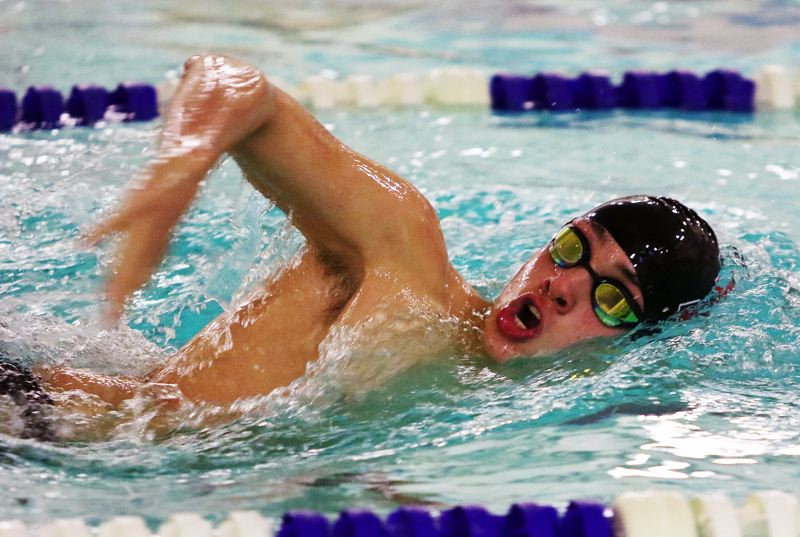 TIMES PHOTO: DAN BROOD - Tualatin senior Thomas Goforth swam to victory in the 500-yard freestyle event during the Timberwolves' meet with Lakeridge.