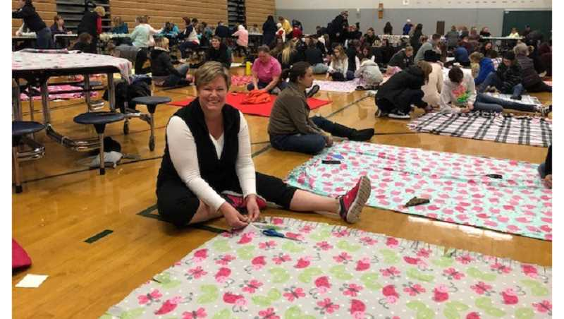 The gym at Baker Prairie Middle School was filled with volunteers making blankets for homeless students in Canby and Molalla.