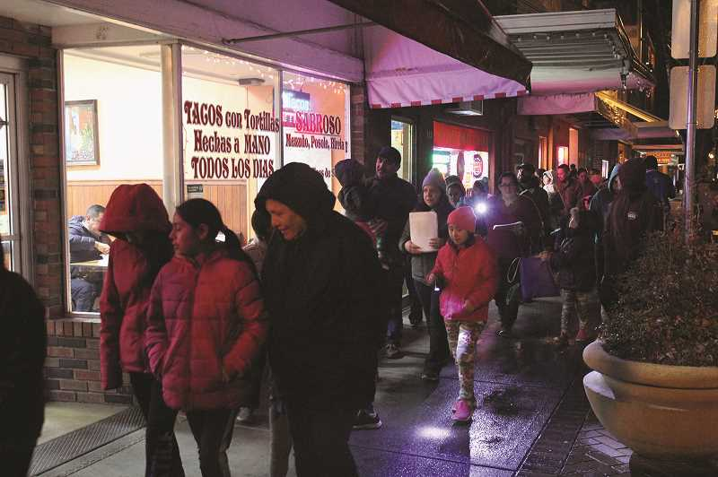 PHIL HAWKINS - Woodburn carolers sang up and down the downtown business corridor on Friday, Saturday and Sunday.
