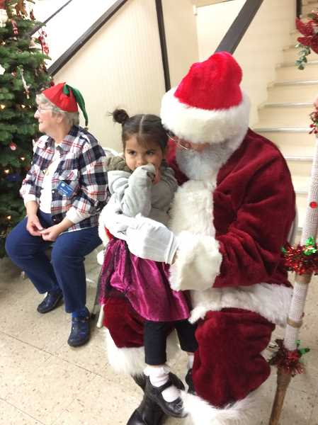 CAROL ROSEN - Santa stopped by the Canby Kiwanis Food and Toy Drive this year to visit with the children.