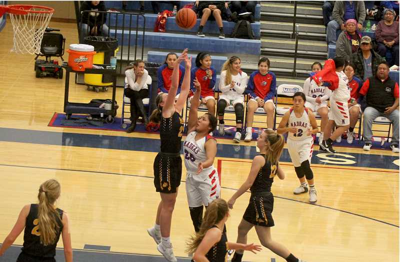 STEELE HAUGEN - Jiana Smith-Francis tries to shoot a floater over the top of a tall Bend High defender. Smith-Francis finished the game with 14 points.