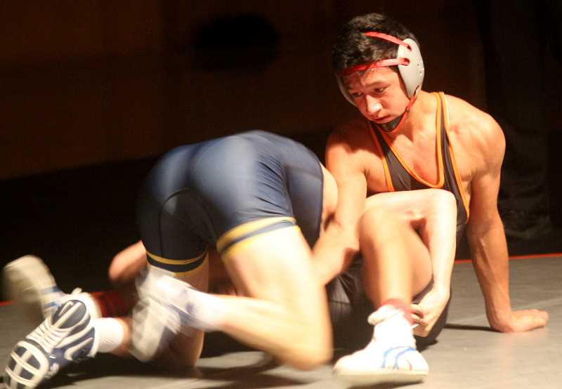 STEELE HAUGEN - Anthony Hood tries to avoid a takedown during his 138-pound match on Dec. 13. Culver bested Bend 63-12.