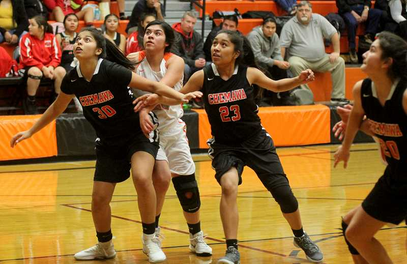 STEELE HAUGEN - Nena Mendoza works hard to get a rebound during the Dawgs' 41-23 victory over the Chemawa Braves.