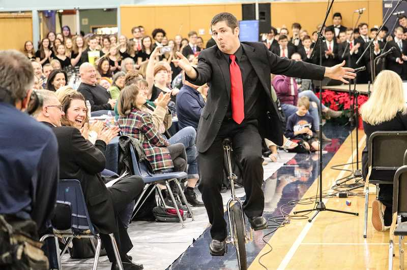 PHOTO COURTESY OF ANDREW KILSTROM - Band Director Chad Davies performs a trick for the crowd at the Wilsonville Winter Festival.