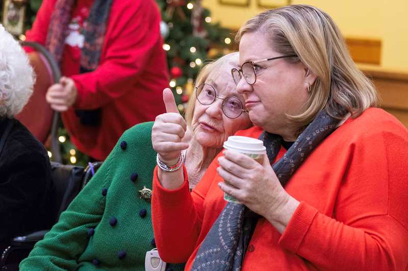 SPOKESMAN PHOTO: CLARA HOWELL  - Boeckman Creek Principal Lindy Sproul, right, and her mother, Patricia Trappe, listen to the Boeckman Creek Senior Choir perform for SpringRidge residents.