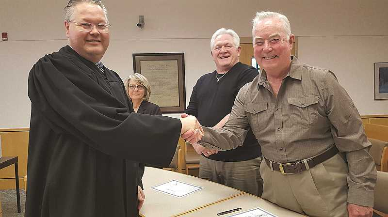 COURTESY PHOTO: CASA OF MARION COUNTY - Woodburn resident Robert Carney (right) is pictured in this 2016 photo being sworn in as a Court Appointed Special Advocate by Marion County Judge Lindsay Partridge.