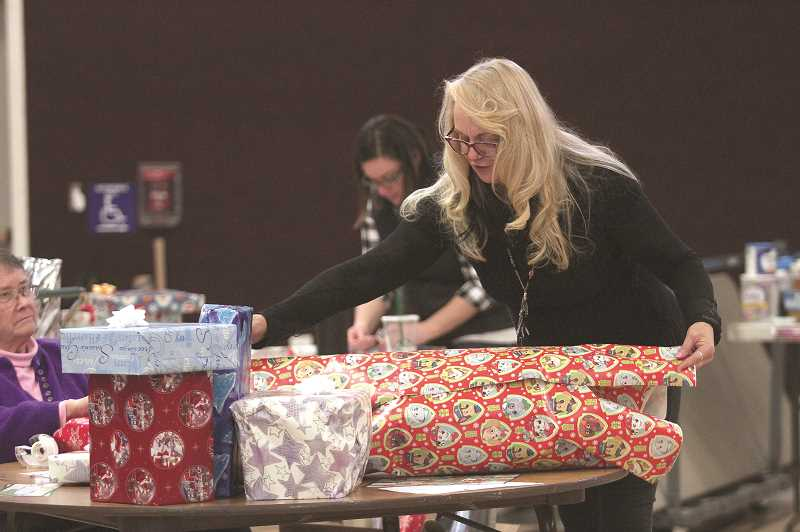 PHIL HAWKINS - Robin Zobrist was one of dozens of volunteers who helped with Love Santa this holiday season.