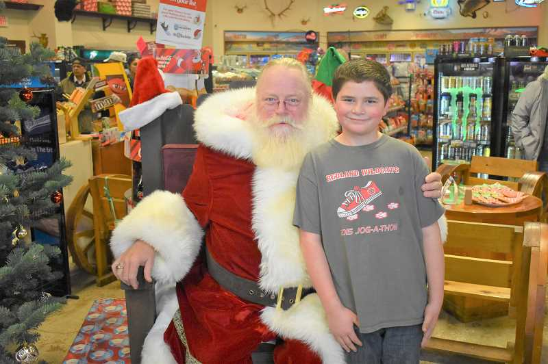ESTACADA NEWS PHOTO: EMILY LINDSTRAND - Children enjoyed visiting with Santa at Barton Store during the communitys new Christmas Corner event last weekend.