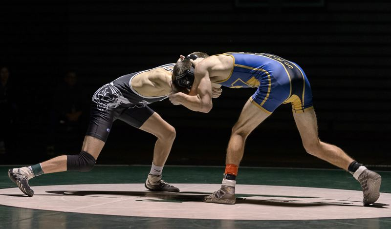 CHRISTOPHER GERMANO: FOR THE TIMES - The Tigard High School wrestling team opened its Three Rivers League schedule by scoring a 43-28 win over Canby.