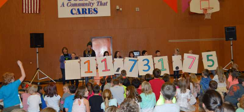 CINDY FAMA - The jog-a-thon fundraising total is revealed at a recent assembly.