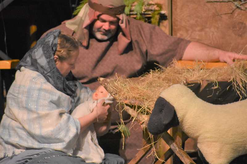 ESTACADA NEWS PHOTO: EMILY LINDSTRAND - Parishoners at Barton Church portrayed Mary and Joseph during a live nativity during Barton Christmas Corner last weekend.