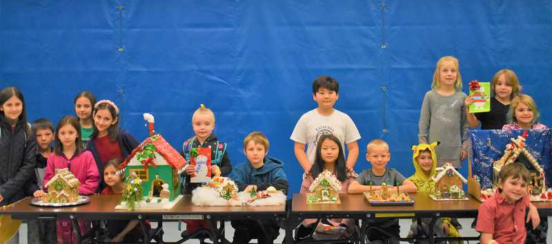 ESTACADA NEWS PHOTO: EMILY LINDSTRAND - River Mill Elementary School students showcase the greations they made for the school's gingerbread house competition.