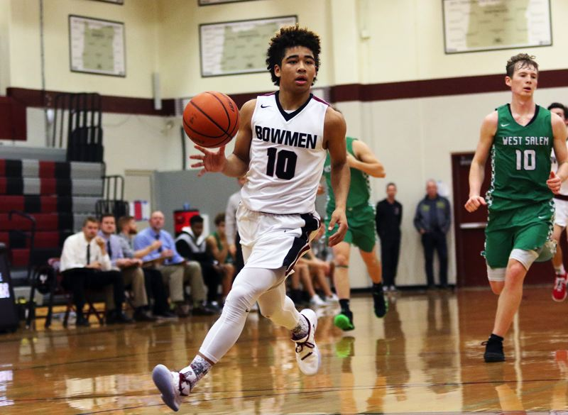 TIMES PHOTO: DAN BROOD - Sherwood junior guard Jamison Guerra leads a fastbreak during overtime in the Bowmen's 65-59 win over West Salem on Tuesday.