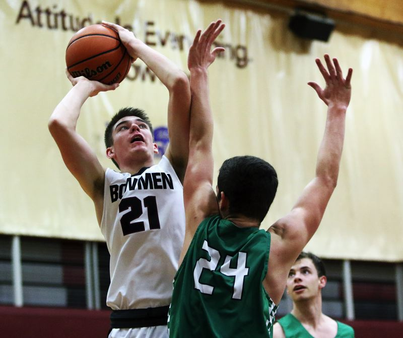 TIMES PHOTO: DAN BROOD - Sherwood senior Braden Thorn (left) shoots over West Salem's Jackson Lowery during Tuesday's game.