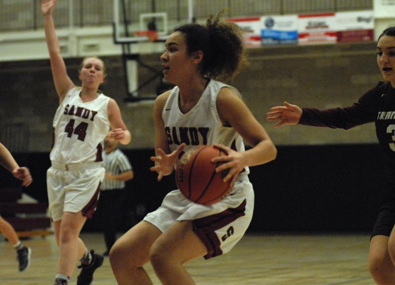 SANDY POST: DAVID BALL - Sandys Athena Thomas pulls up near the baseline, while teammate Alyssa McNutt, 44, runs the floor during the Pioneers 46-35 home loss to Franklin.