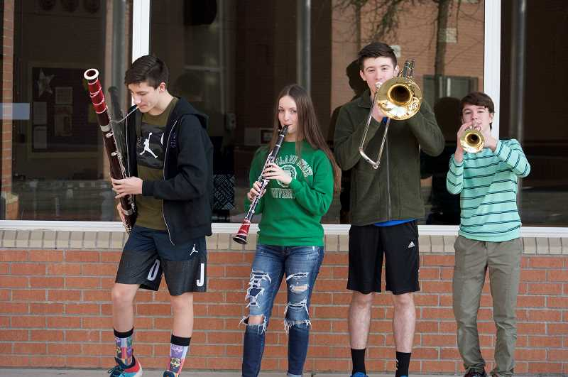 TIDINGS PHOTO: CLARA HOWELL - From left to right: Athey Creek eighth-graders Reese Hunsaker, Dina Biggs, Noah Eddy and Thomas Uelmen were selected for the middle school OMEA All-state Band.