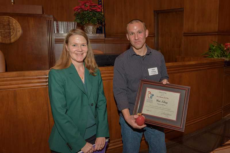 SUBMITTED PHOTO  - Oregon Appeals Court Judge Erin Lagesen, left, presents Matt Kellogg, right, with the Civic Educator of the Year award.