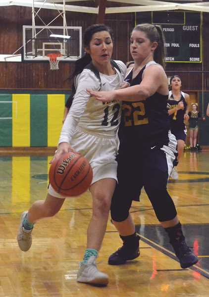 PIONEER PHOTO: TANNER RUSS - Kaelie Gates was one of three double-digit scorers for the Lady Vikings against Sheridan.