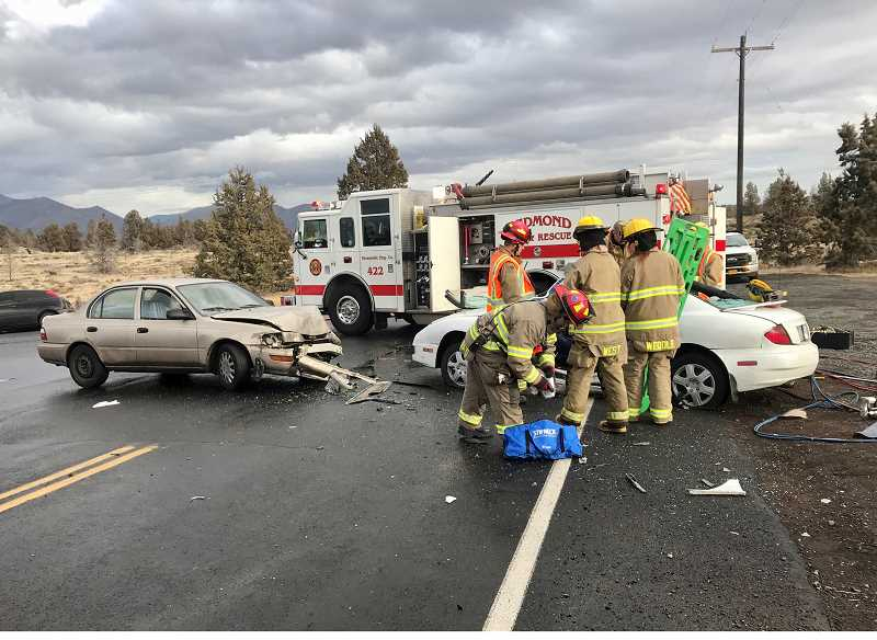 SUBMITTED PHOTO - Emergency responders tend to the victims of a two-car crash on Dec. 11, at Crooked River Ranch. CRR and Redmond fire departments worked to extricate the driver, who was transported to St. Charles Redmond with serious injuries.