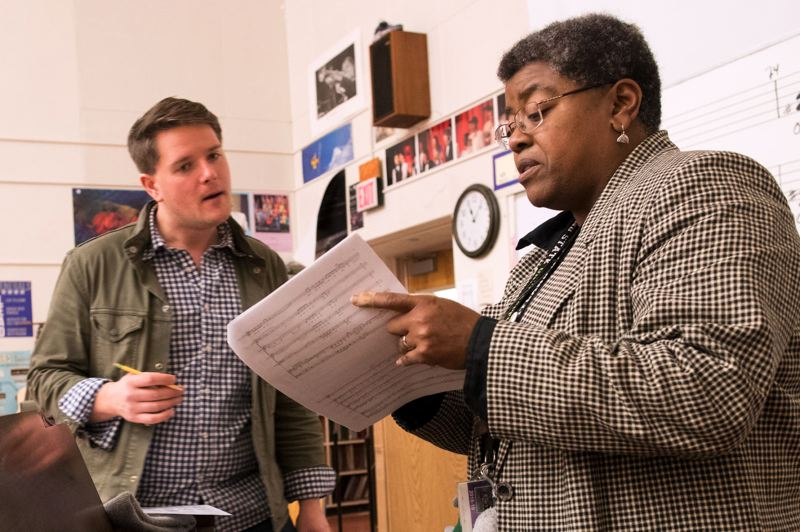 TRIBUNE PHOTO: JAIME VALDEZ - John Eisemann, a teacher at Grant High School and Judy Rose, a teacher at Lane Middle School, go over last-minute changes on a song that Rose composed before the high schools choir sings it.
