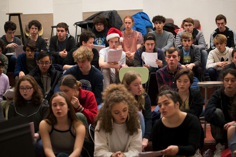 TRIBUNE PHOTO: JAIME VALDEZ - Finley Greene, Santa hat, a sophomore at Grant High School, sings with the schools choir while rehearsing a song composed by Judy Rose, a teacher at Lane Middle School.
