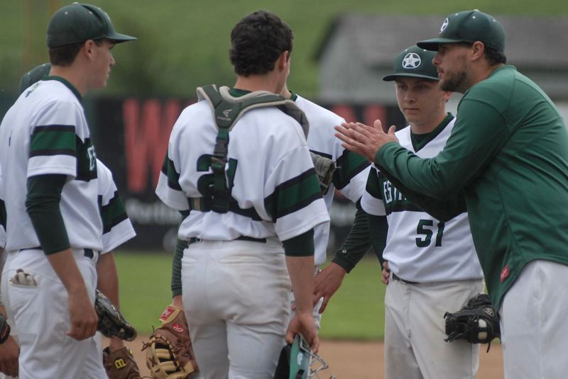 FILE PHOTO - Estacada baseball coach Andrew Higgins instructs his players during a game last spring.