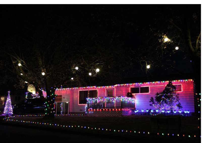 HOLLY M. GILL/MADRAS PIONEER - A home on Northeast Chestnut Street, owned by Miguel Avina, is surrounded by lights, including those hanging from the trees.