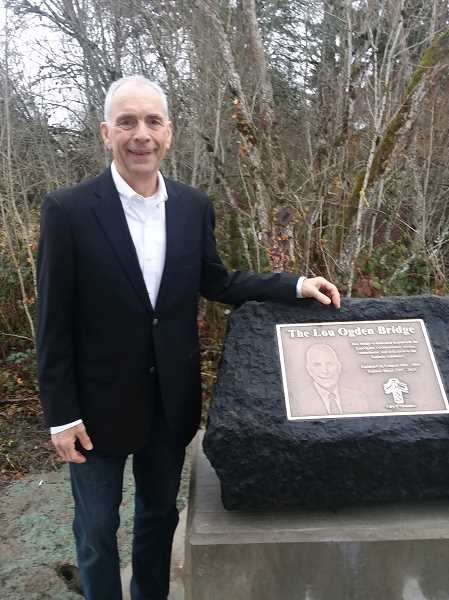 TIMES PHOTO: RAY PITZ - Tualatin Mayor Lou Ogden stands in front of the bronze plaque that reveals a bridge named in his honor. After two decades, Ogden is finishing up his final term as mayor.