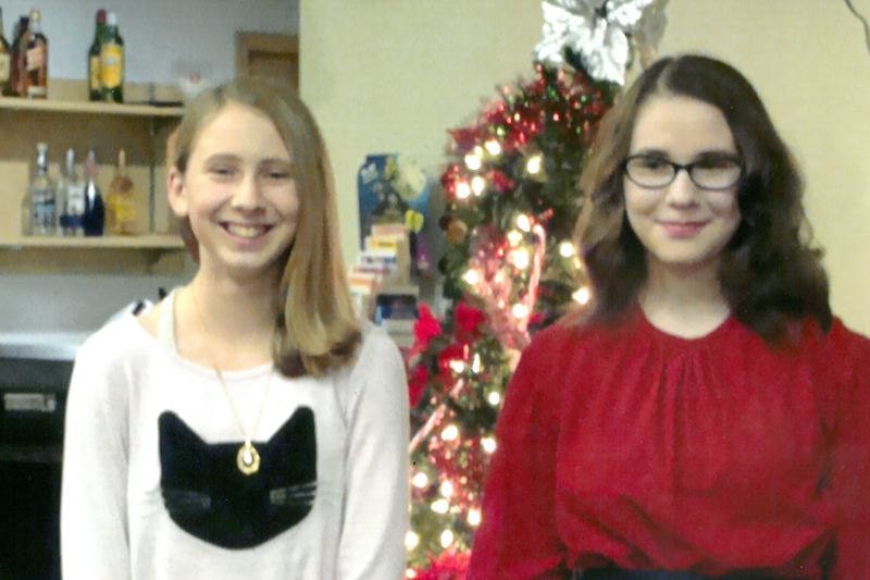 PHOTO COURTESY OF SALLY ANN MARSON - Alexis Jenkins, left, and Maria Burns, right, were recognized by the St. Helens Veteran of Foreign Wars and Auxiliary for their entries into the annual Patriots Pen and Voice of Democracy essay contest. Jenkins, who entered the middle school level Partiots Pen contest, was also selected as a district-level winner and will now compete for state recognition.