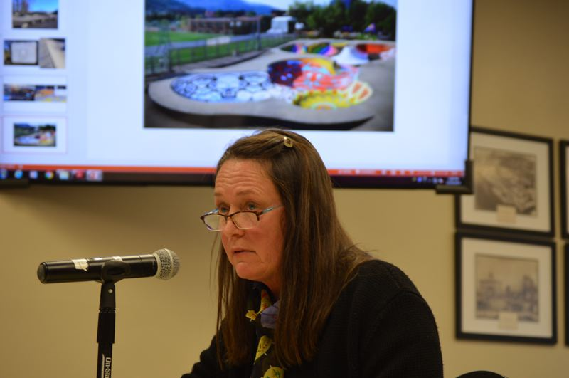 SPOTLIGHT PHOTO: NICOLE THILL-PACHECO - Arts and Cultural Commission member Lisa Brooke speaks during a St. Helens City Council work session on Wednesday, Dec. 19. Behind her is an example of a mural painted at a skate park, a project she hopes the ACC can help create at the McCormick Park skate park next year.
