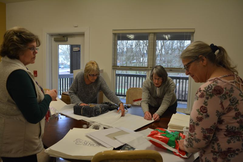 SPOTLIGHT PHOTO: COURTNEY VAUGHN - Volunteers wrap gifts at the St. Helens Senior Center for the Be a Santa to a Senior program. Pictured left to right: Annette Shinkle, Carolyn Zent, Sue Mueller and Linda Joy Prettyman.