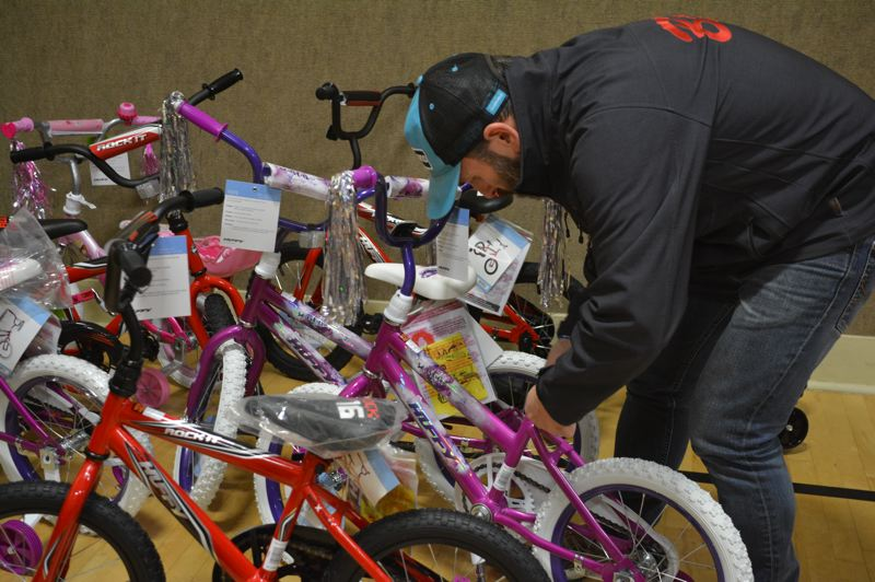 SPOTLIGHT PHOTO: COURTNEY VAUGHN - Paul Barlow of Barlow Bikes runs a quality control check on assembled bikes during a build-a-bike session in Columbia City.