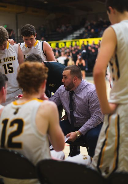 PHOTO COURTESY: JEREMY DUECK - Coach Zach Waldher gives instructions to the St. Helens Lions during a timeout. The Lions will finish their nonleague slate with three home games: Dec. 28 vs. Reynolds, Jan. 2 vs. Hood River Valley and Jan. 4 vs. The Dalles.