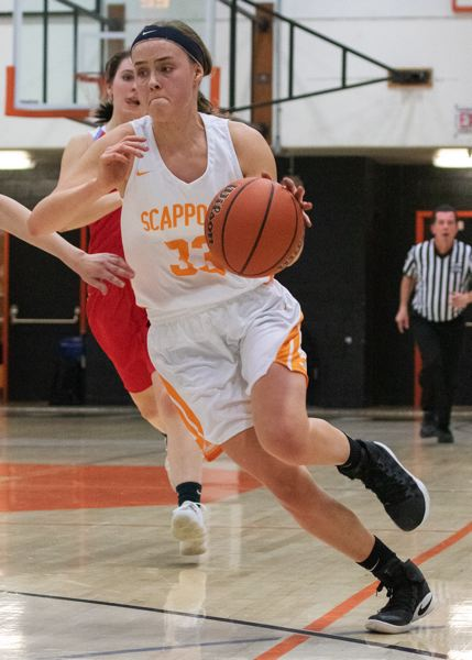 PHOTOS COURTESY: LOREN WOHLGEMUTH - Post Emily Kopra of Scappoose pushes the pace in a home game last week against Seaside.