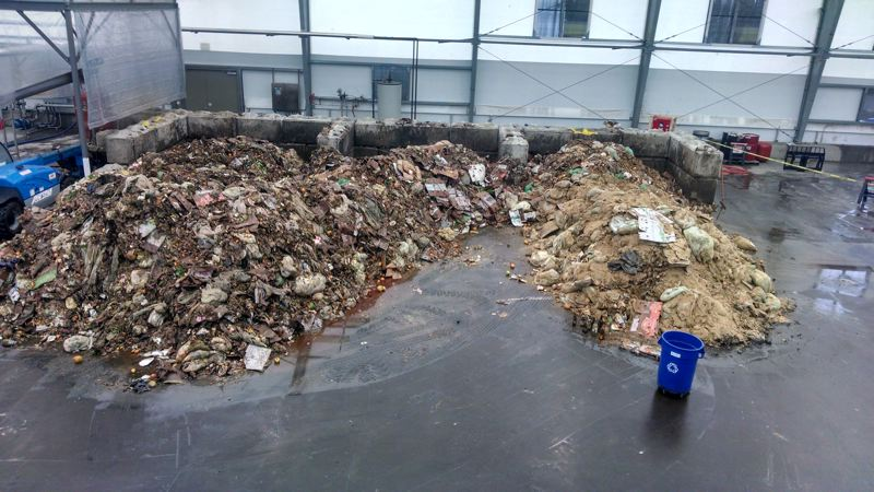 COURTESY OF METRO  - Piles of food scraps cover the floor of the JC Biomethane in Junction City back in 2014.